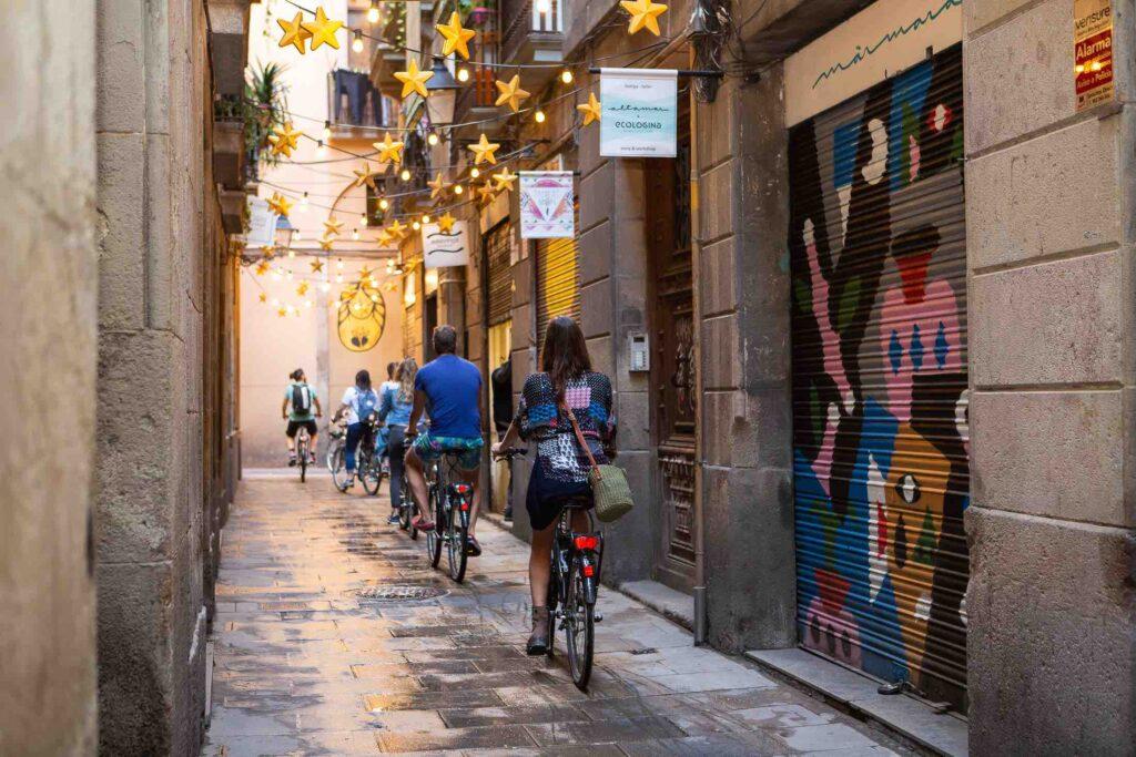 Woman enjoying a Baarcelona bike tour in a quiet alley-cropped