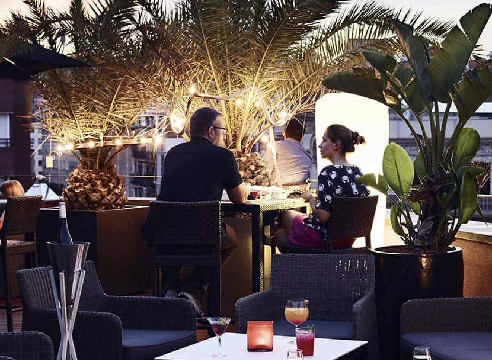 Villa Emilia people sitting at the Zinc Bar outdoors
