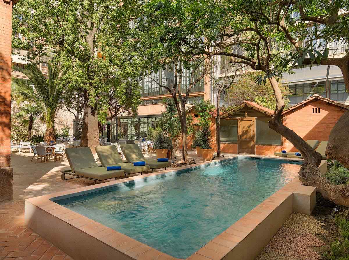 H10 Casa Mimosa pool area in summer with shay trees