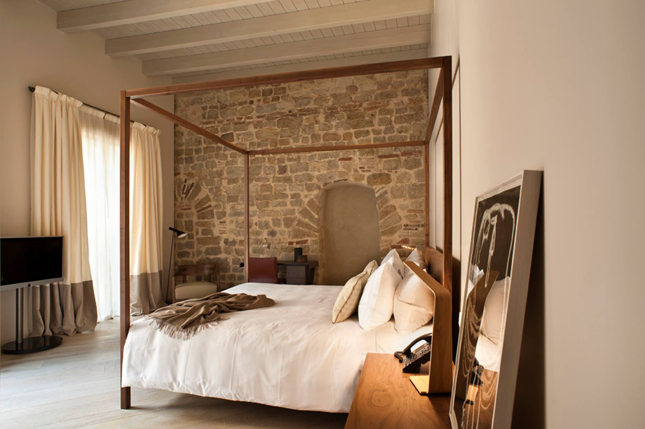 Mercer Hotel's historic rooms with old walls form one of the bedrooms of this boutique htoels in Barcelona bedroom