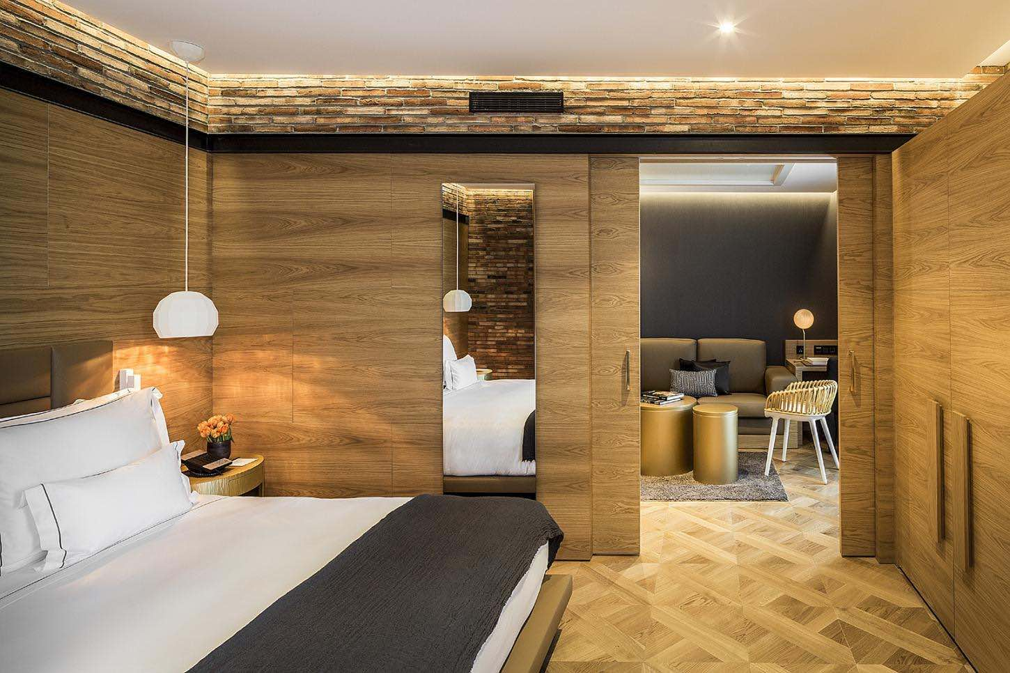 Suite at Monumnet hotel one of the top boutique hotels in Barcelona with bed and bathroom